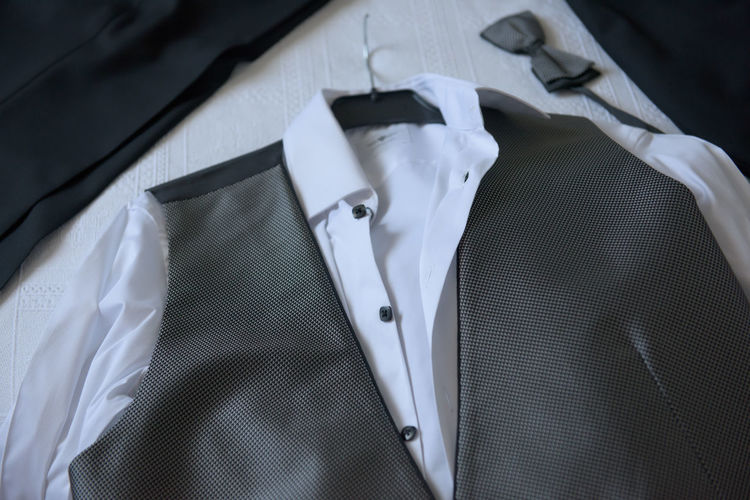 High Angle View Of Waistcoat And Shirt On Table