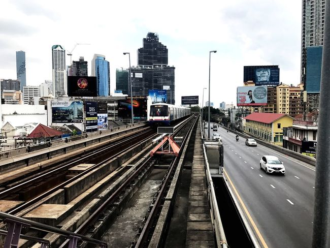 Perspective Railway BTS Transportation Train BKK Coulds And Sky Road Parallel City Transportation Building Exterior Architecture City Built Structure Railroad Track Mode Of Transport Sky Land Vehicle Rail Transportation Car Outdoors Public Transportation No People Cityscape Day Urban Skyline Skyscraper EyeEmNewHere The Secret Spaces EyeEm Diversity The Street Photographer - 2017 EyeEm Awards