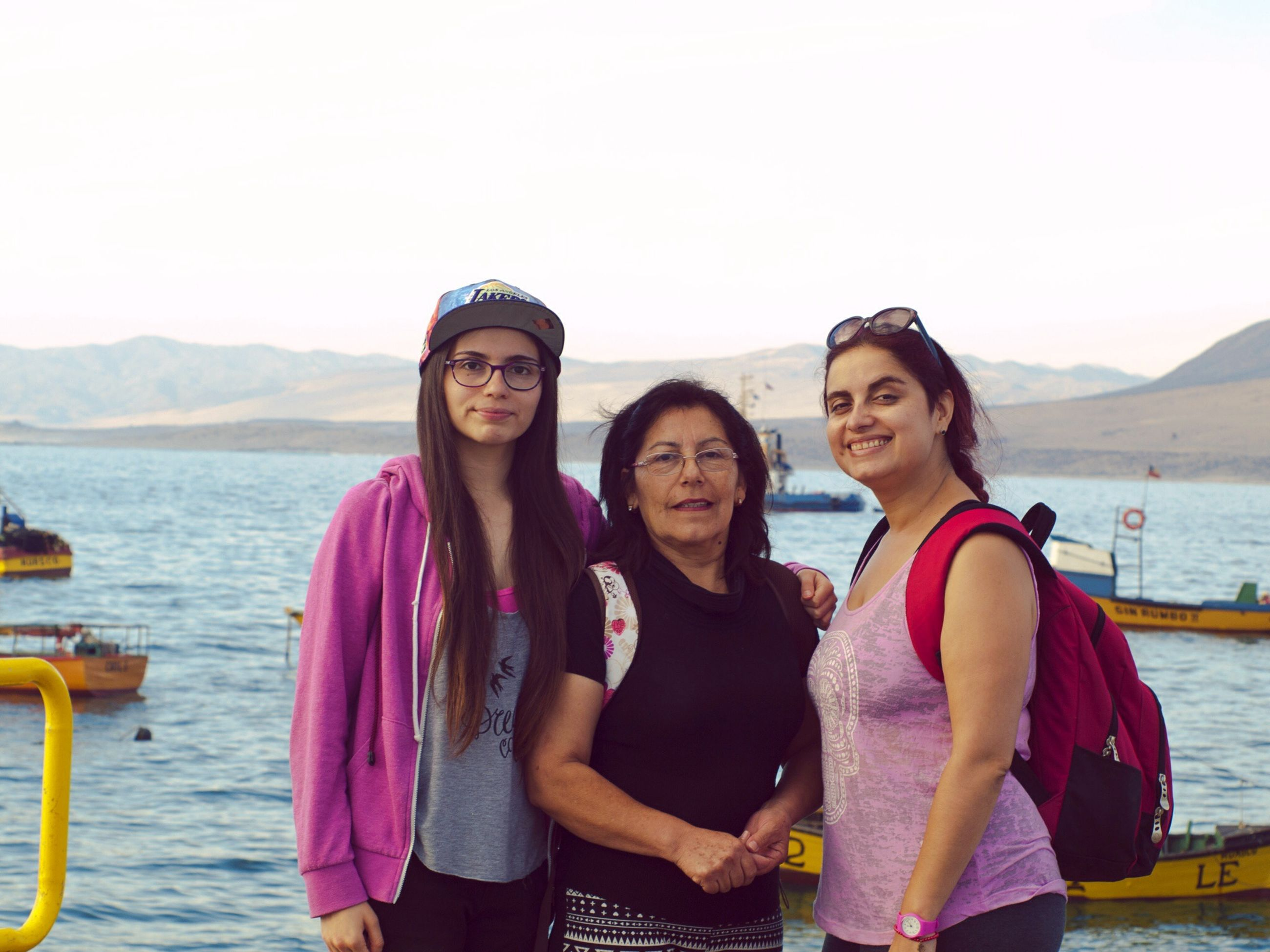 togetherness, lifestyles, leisure activity, bonding, water, casual clothing, person, love, friendship, smiling, young adult, looking at camera, happiness, portrait, vacations, standing, young women, front view