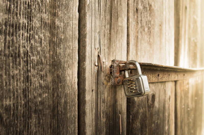 Close-up of padlock on wooden door