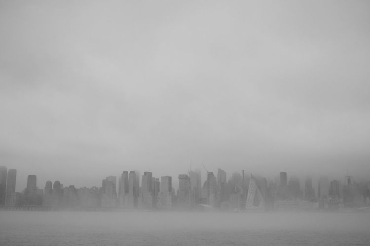 Manhattan in Fog River Hudson River Fog Skyscraper Building Exterior Architecture Urban Skyline City Cityscape Outdoors Fog Water Mist
