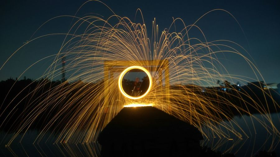 Man with wire wool at night