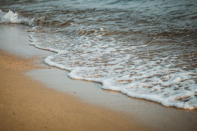 High angle view of waves rushing towards shore