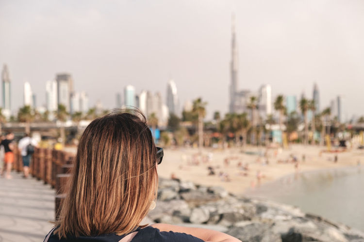 Portrait of woman looking at dubai skyline