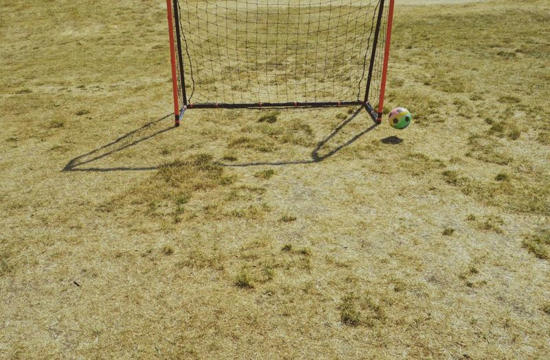 High angle view of goal on soccer field