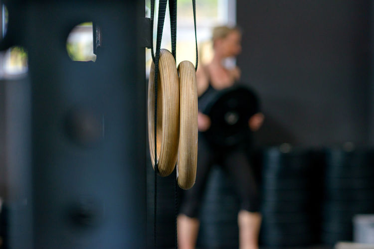 Close-Up Of Gymnastic Rings Hanging In Gym