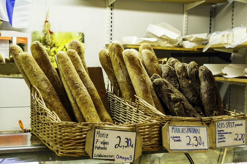 Assorted baguette breads in bakery shop