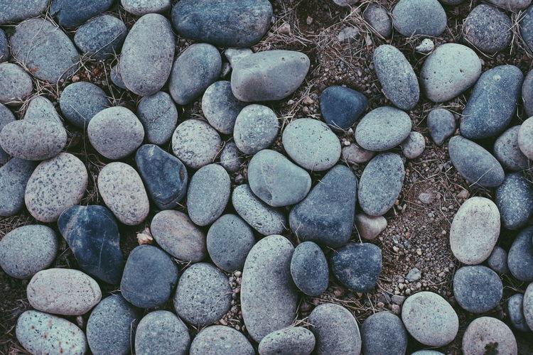 High angle view of pebbles on sand