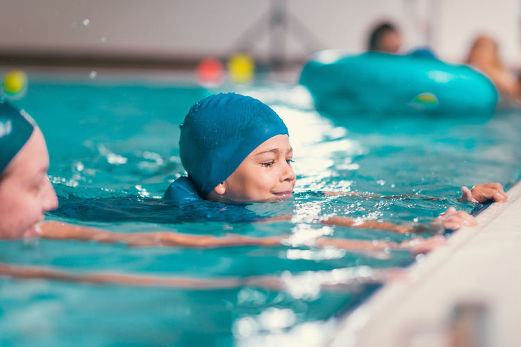 Portrait of a boy swimming in pool