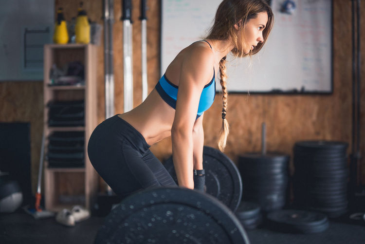 Deadline Athlete Beautiful Woman Blonde Girl Day Exercise Equipment Exercising Fitness Model Focus On Foreground Gym Health Club Healthy Lifestyle Indoors  Leisure Activity Lifestyles One Person People Real People Sport Sports Clothing Sports Training Strength Weightlifting Young Adult Young Women