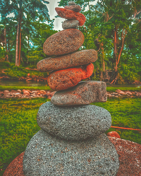 Stack of stones on field