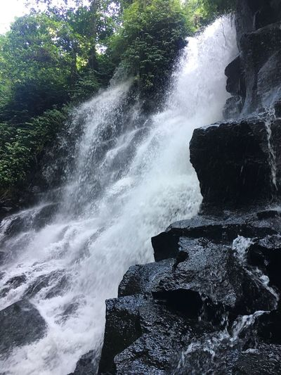 Black stone waterfall Motion Nature Beauty In Nature Scenics Waterfall Rock - Object Water Blurred Motion Outdoors No People Splashing Forest Power In Nature Tranquility Tranquil Scene Rapid Waterfalls