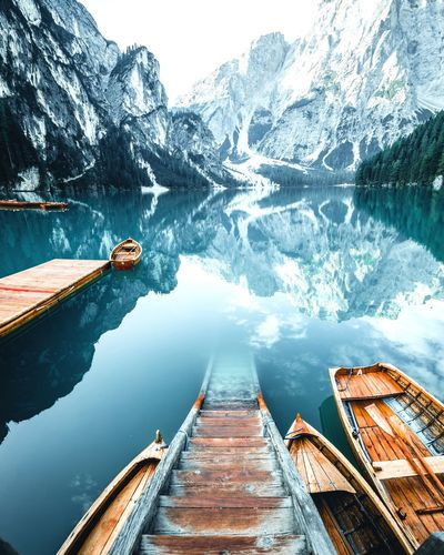 Pragser Wildsee Lago Di Braies Boat Water Reflection Beauty In Nature Lake Transportation Nature Scenics - Nature Outdoors Pier Cold Temperature No People