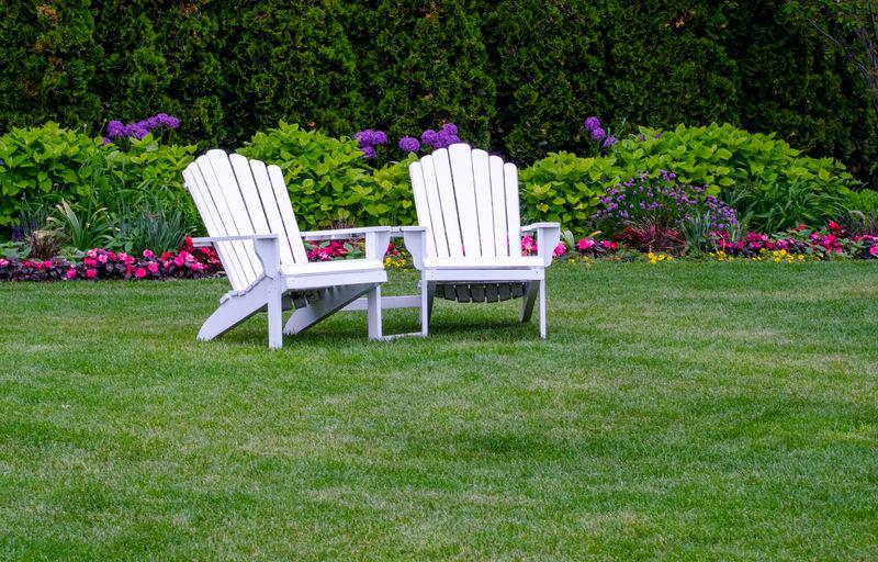 Adirondack chairs on a manicured lawn
