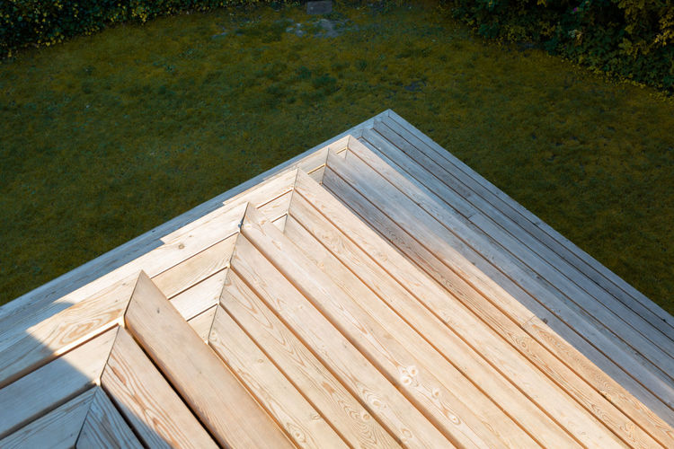 High angle view of wood by water