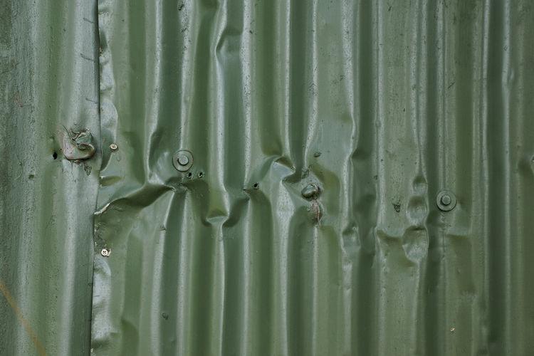Full frame shot of damaged corrugated iron