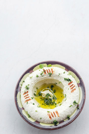 lebanese hummus dip DIP Mezze Snack Tapas Appetizer Bowl Chickpea Chickpea Dip Close-up Day Food Food And Drink Freshness Garnish Gourmet Healthy Eating High Angle View Hummus Indoors  Lebanese Middle Eastern Food No People Ready-to-eat Soup Studio Shot Traditional White Background