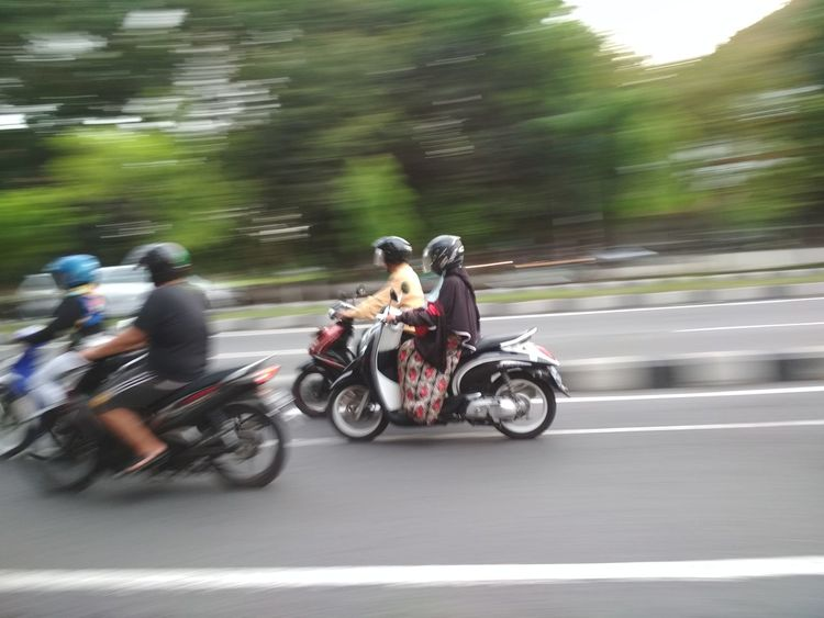 Motorcycle Speed Blurred Motion Riding Motion Crash Helmet On The Move Transportation Headwear Adventure Sports Race Road Sports Helmet Biker Motorcycle Racing Mode Of Transport Motorsport Group Of People Adults Only Adult panning