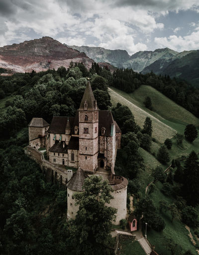 old castle in good condition in austria drone aerial photo Mountain Architecture Built Structure Sky Tree Mountain Range Building Exterior Nature Scenics - Nature Cloud - Sky Building Plant Landscape Day Environment No People Beauty In Nature Travel Destinations The Past History Outdoors