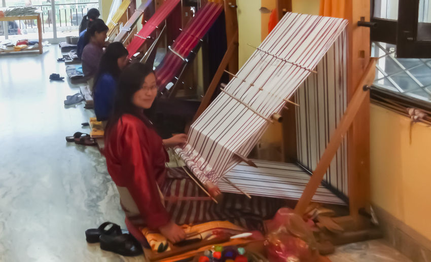 Architecture Bhutan Bhutanese Day Full Length Girl Girls Indoors  Industrial Insdustrial Lifestyles Real People Sitting Textile Textiles Travel Travel Photography Traveling Travelphotography Two People Woman Women Woven Woven Fabrics Wovenhand