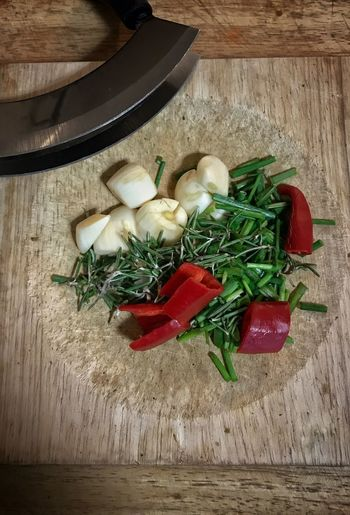 Chilli, Rosemary, Chives & Garlic ready for chopping Vegetable Garlic Food And Drink Spice Table Food High Angle View Wood - Material Preparation  Cutting Board Herb No People Ingredient Close-up Freshness Indoors  Raw Food Healthy Eating Day