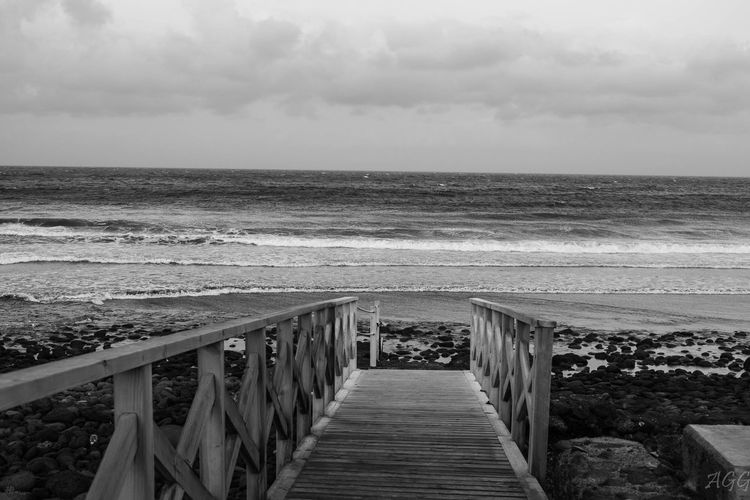 Beach Beauty In Nature Day Horizon Over Water Jetty Nature No People Outdoors Railing Scenics Sea Sky Tranquility Water Wave Wood Paneling