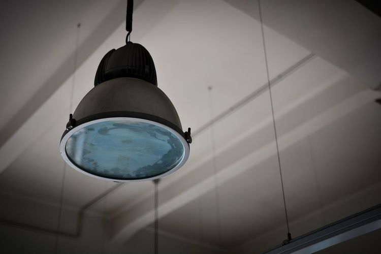 Low Angle View Of Lamp Hanging From Ceiling