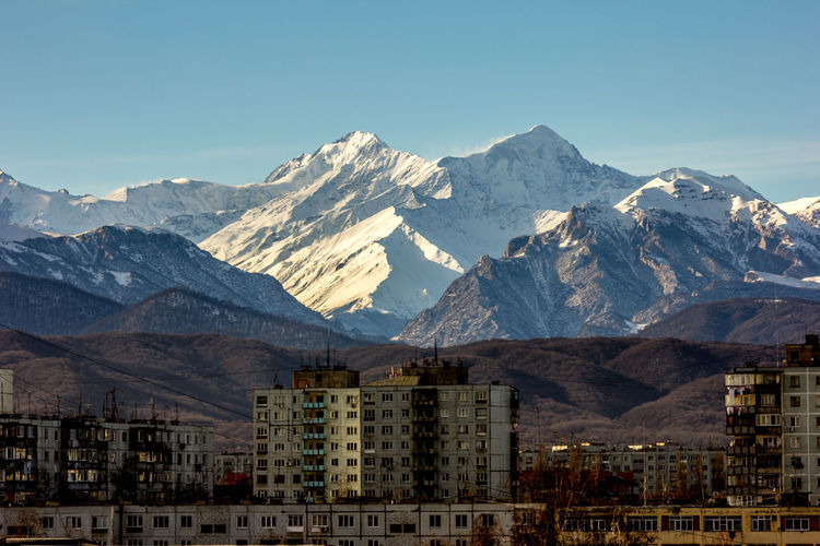View of city against mountain range