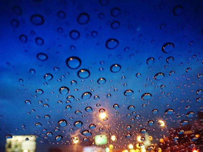 Full frame shot of wet window in rainy season