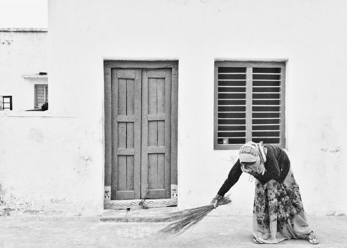 View of woman standing against building