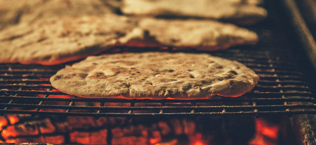 Close-up of flatbread on barbecue grill