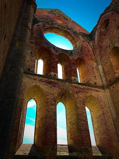 Building Exterior Outdoors No People Low Angle View Clear Sky Built Structure History Travel Destinations Blue Architecture Place Of Worship Arch Old Ruin Low Angle View The Past Architecture Ancient Day Window Sunlight Sky Clear Sky Ancient Civilization Nature