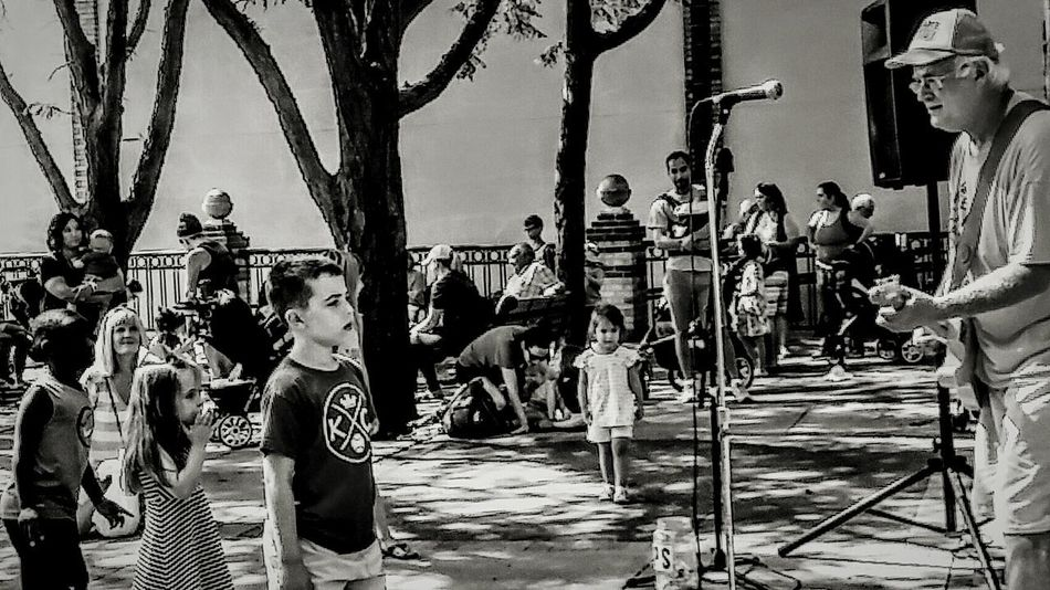 Outdoors Community Tree Shadows Guitar Hero Children Summer ☀ Childhood Motion Irwin Collection Cheerful Fun Leisure Activity EyeEm Gallery Happiness EyeEm Best Shots Farmers Market Band Photography Music Photography  Music Photography  DANCE ♥ Irwin Collection EyeEm Best Shots - Black + White