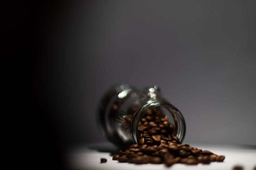 Want to have some coffee? Black Background Brown Close-up Coffee Coffee - Drink Coffee Bean Container Copy Space Food Food And Drink Freshness Glass - Material Indoors  Light And Shadow No People Roasted Coffee Bean Selective Focus Still Life Studio Shot Table Temptation Wealth