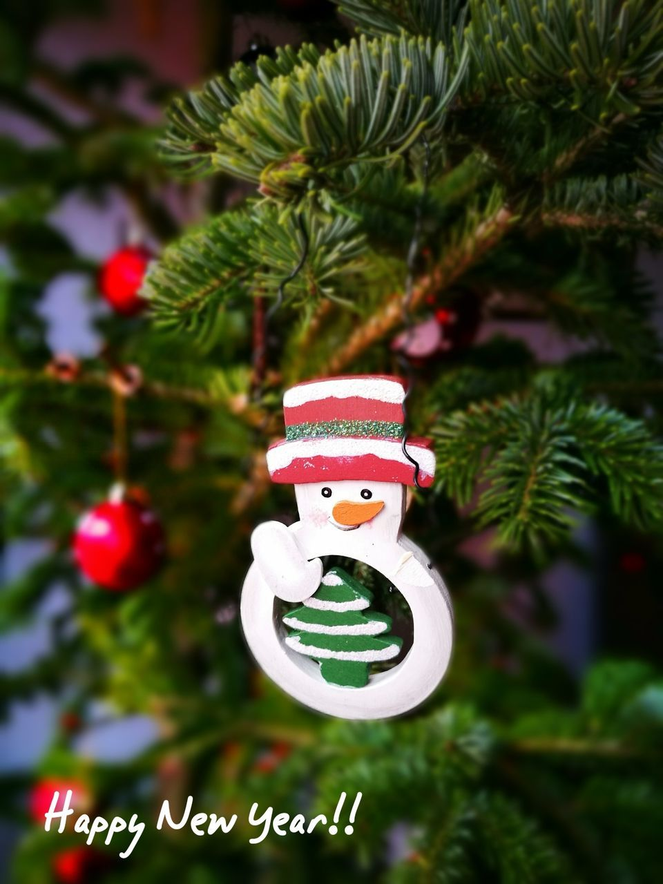 christmas, celebration, christmas tree, christmas decoration, decoration, green color, tradition, human representation, close-up, no people, christmas ornament, focus on foreground, cultures, holiday - event, indoors, hanging, tree, snowman, vacations, day