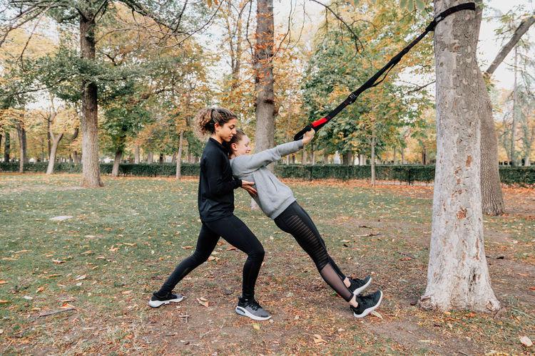 Beautiful women exercising outdoors