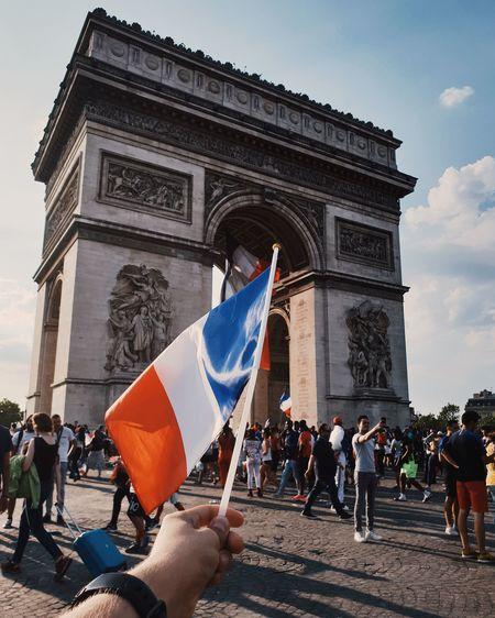 Vive la France! 🇫🇷 Paris France Paris, France  Mood City Politics And Government Men Crowd Flag Women History Sky Architecture Built Structure Triumphal Arch National Monument French Flag Place Of Interest Visiting Memorial Arch City Gate