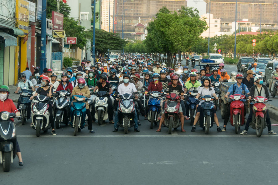Motor cycles in Saigon, Vietnam Adult Adults Only Architecture Building Exterior Built Structure City Crowd Crowded Crowded Street Day Ho-Chi-Minh City Large Group Of People Men Motor Bike Motor Scooter Motorcycles NIKON D5300 Outdoors Parade People Real People Saigon Traffic Vietnam Adventures In The City Adventures In The City