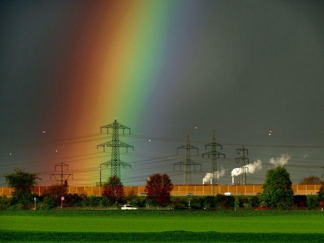 High voltage Beauty In Nature Cloud - Sky Field Grass Green Color Hochspannungsleitung Landscape Multi Colored Outdoors Rainbow Regenbogen Sky Weather