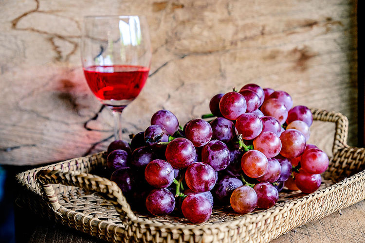 Glass of wine and grapes Beverage Red Rustic Alcohol Background Basket Bottle Corkscrew Drink Food And Drink Glass Grape Grapes Grapes 🍇 Healthy Eating Luxury Purple Table Wine
