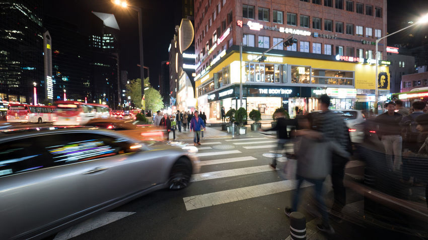 SEOUL, SOUTH KOREA - OCTOBER 22, 2015: Pedestrians crossing the road on zebra in big night illuminated city Architecture Auto City City Life City Street Cross Crossing Horizontal Illuminated Metropolis Motion Night Outdoors Pedestrian People Person Regulation Regulations Speed Street Zebra