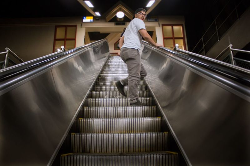 City life EmNewHere Embest Shot Portrait Man Transit Silver  Staircase Railing Steps And Staircases Escalator One Person Architecture Men Indoors  Full Length Low Angle View Walking Technology Motion