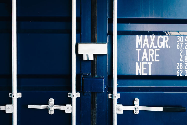 Close up textured photo of blue shipping container with locked doors Dark Locked Secured Shipping Container Shipping Containers Storage Space Textured  Background Background Texture Backgrounds Blue Cargo Cargo Container Closed Metal Seacan Shipping  Shipping Terminal Storage The Still Life Photographer - 2018 EyeEm Awards