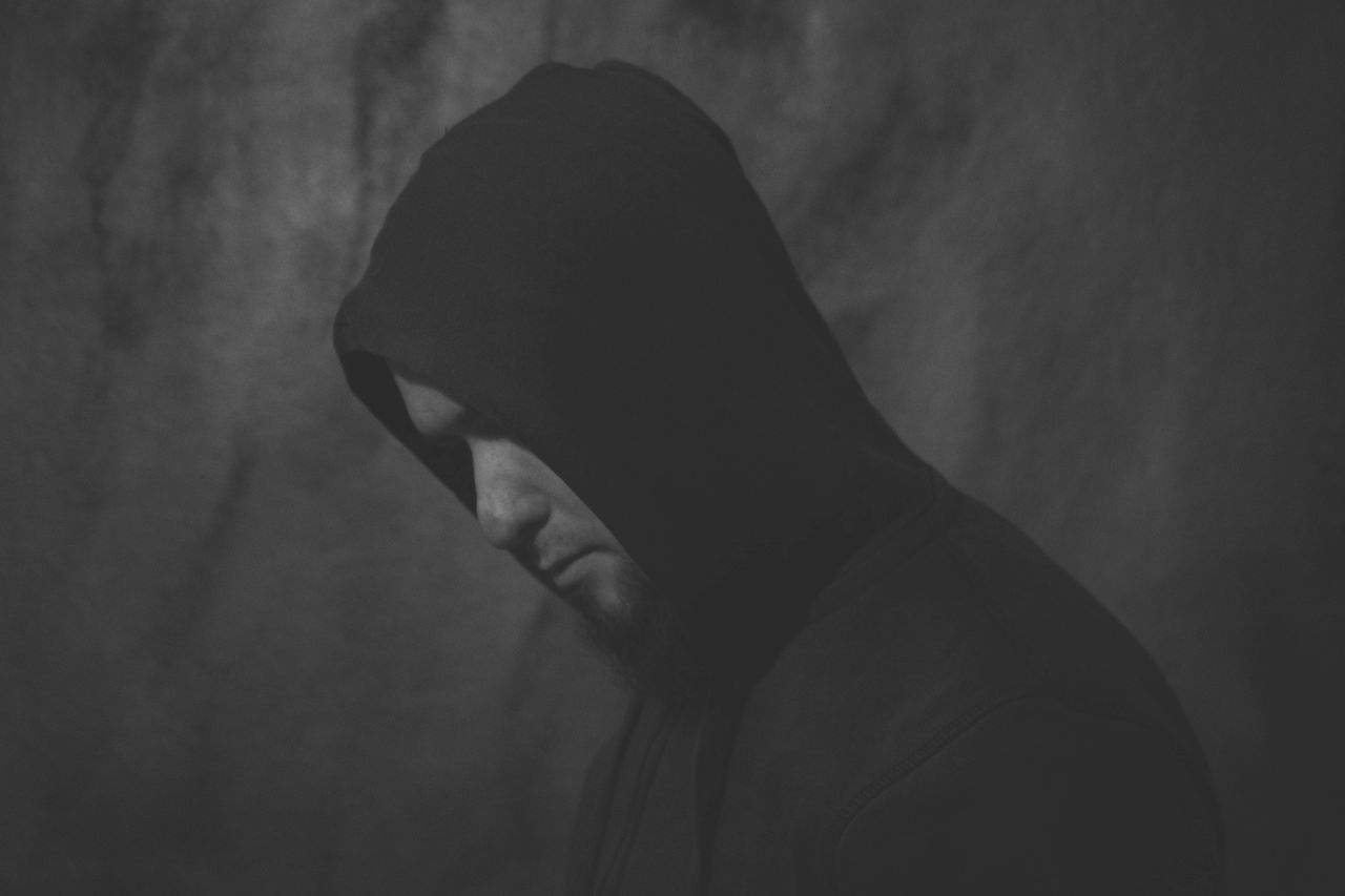 one person, headshot, real people, lifestyles, hood, side view, unrecognizable person, indoors, close-up, portrait, hood - clothing, hooded shirt, leisure activity, clothing, obscured face, covering, body part, waist up, human body part, human face, contemplation, profile view