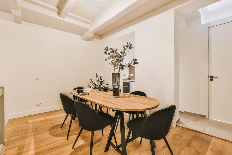 Empty chairs and tables on floor at home