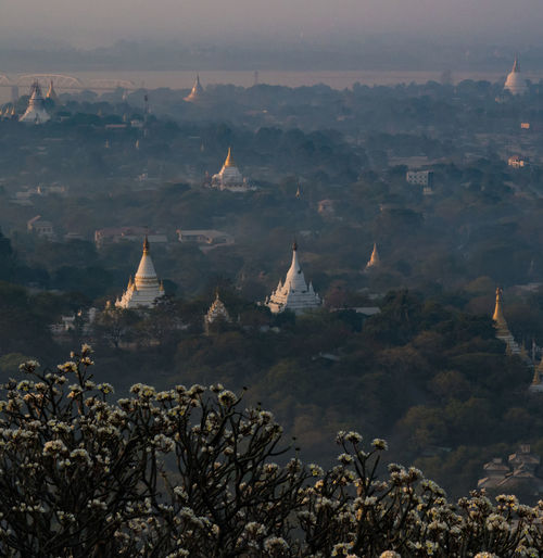 High angle view of stupas at dusk
