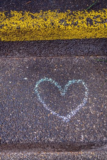 Heart Shape Emotion Positive Emotion Love No People Creativity Symbol Road High Angle View Art And Craft Yellow Directly Above Close-up Drawing - Activity Drawing - Art Product Day Graffiti City Outdoors Valentine's Day - Holiday Herz Herzlich Graffiti Wall Steinstufen