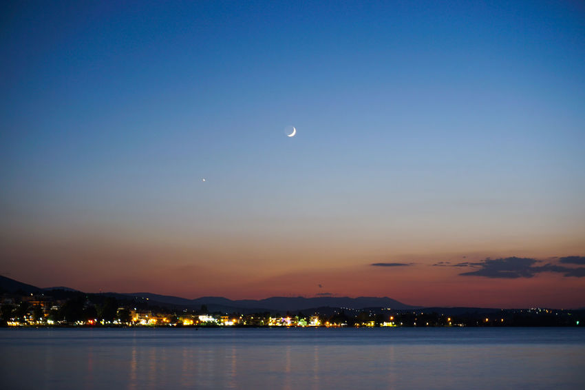 Night capture Architecture Astronomy Beauty In Nature Building Exterior City Crescent Dusk Half Moon Illuminated Moon Mountain Nature Night No People Outdoors Scenics Sea Sky Sunset Tranquil Scene Tranquility Water