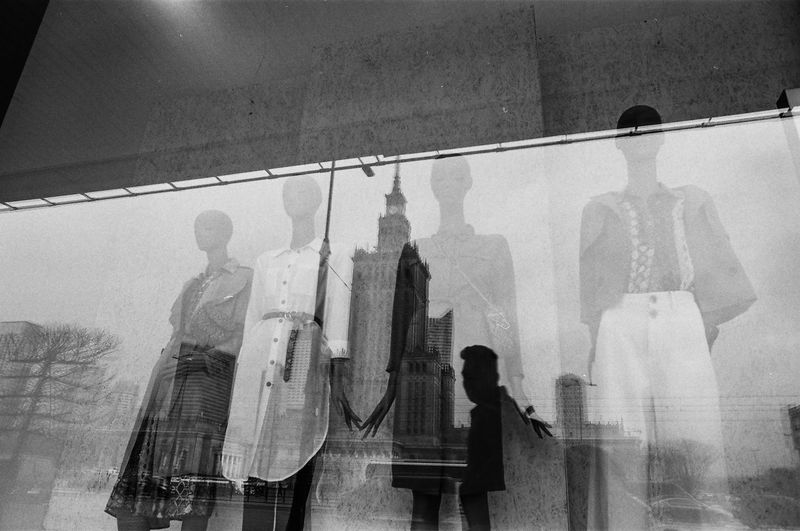 ANALOG Ilford Pan 100 The Week on EyeEm Light And Shadow Analogue Photography Nikonphotography Street Photography Bnw Capture The Moment Film Photography Black And White Reflection Real People People Indoors  Men Architecture Human Representation Adult Women Glass - Material Built Structure Standing Window Leisure Activity Shadow Clothing Full Length Transparent The Art Of Street Photography