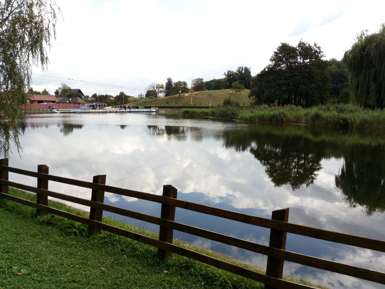 water, tree, river, reflection, nature, outdoors, railing, sky, grass, no people, scenics, day, beauty in nature, riverbank, growth, architecture